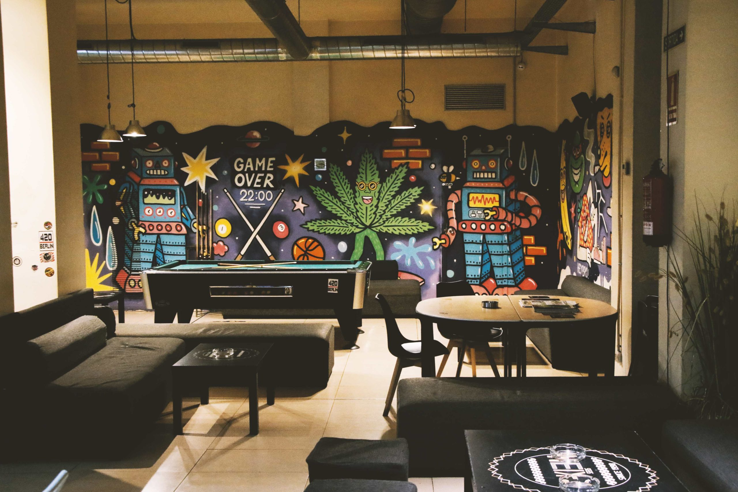 gelato weed club space with pool table chairs sofas